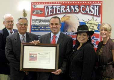"Major (Ret) Eliseo ""Al"" Cantu of the Texas Veterans' Commission stands with State Representative Chris Turner in front of a mock-up of the first Texas Lottery's Veterans Scratch-off game, which will be released on November 9, 2009. Also pictured are State Senators Leticia Van De Putte and Wendy Davis."